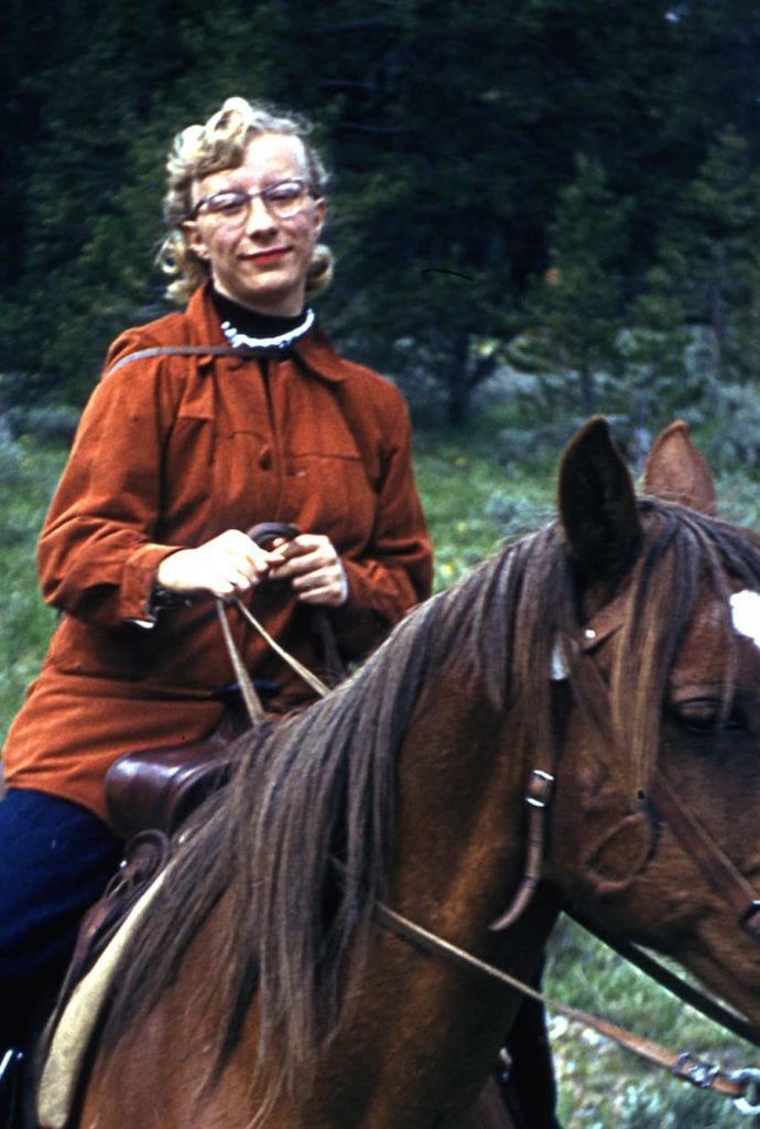 Photo: Anita Wimberly Ouverson riding horseback, apparently wearing pearls. Circa 1955.